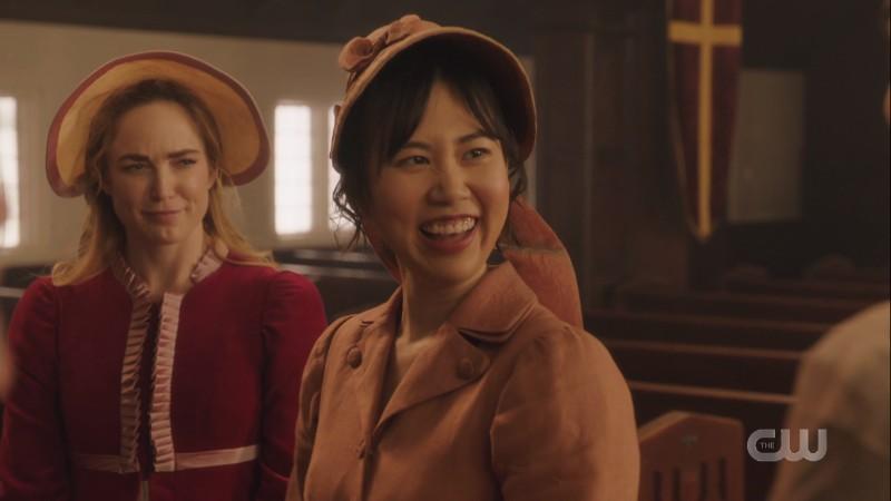Sara smirks at Mona's goofy giggles