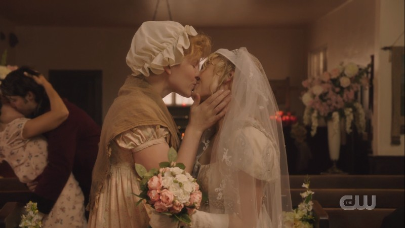 The bride and the scullery maid kiss