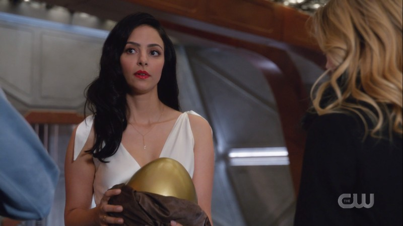 Zari in her white dress with a golden egg