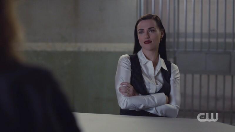 Lena crosses her arms STILL IN THE VEST