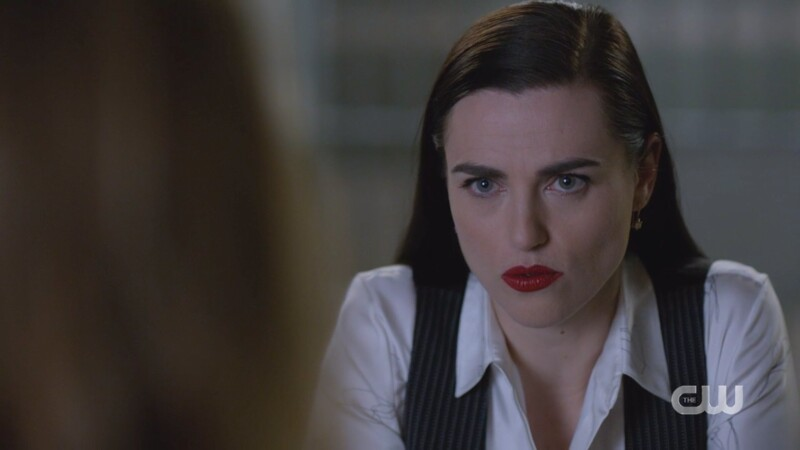 Lena glowers at Lillian (still in the vest)