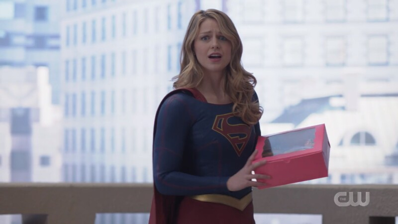 Supergirl comes bearing a pink box of donuts