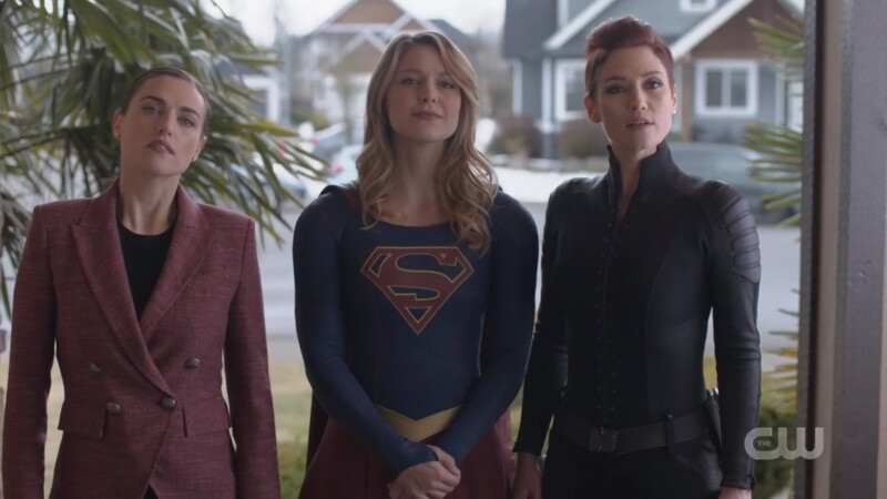 Dr. Lena Luthor, Supergirl, and Director Alex Danvers stand in the doorway togethr