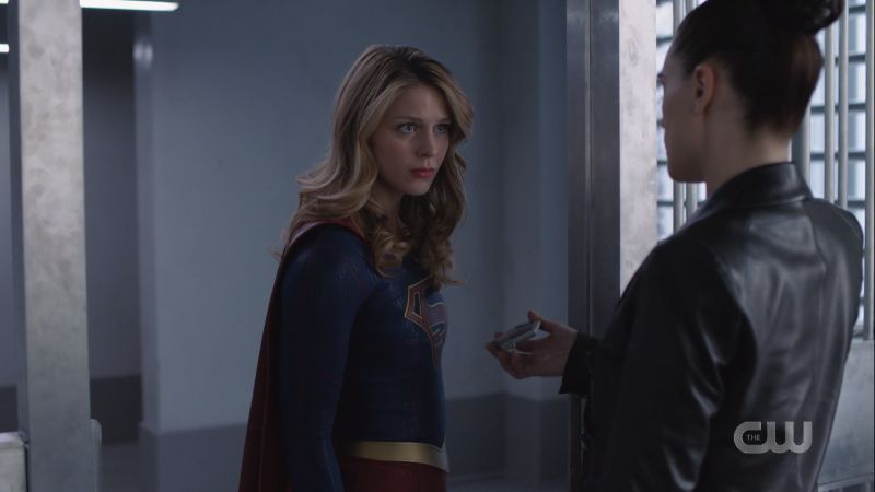 Supergirl looks intensely at Lena