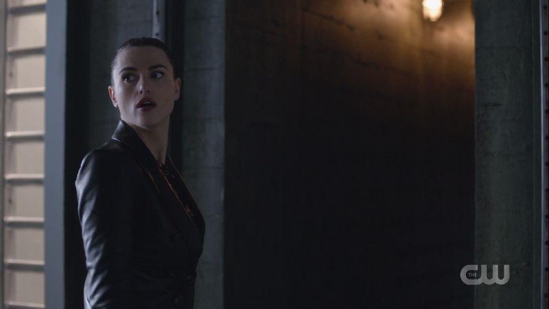 Lena looks back before entering the secret passageway