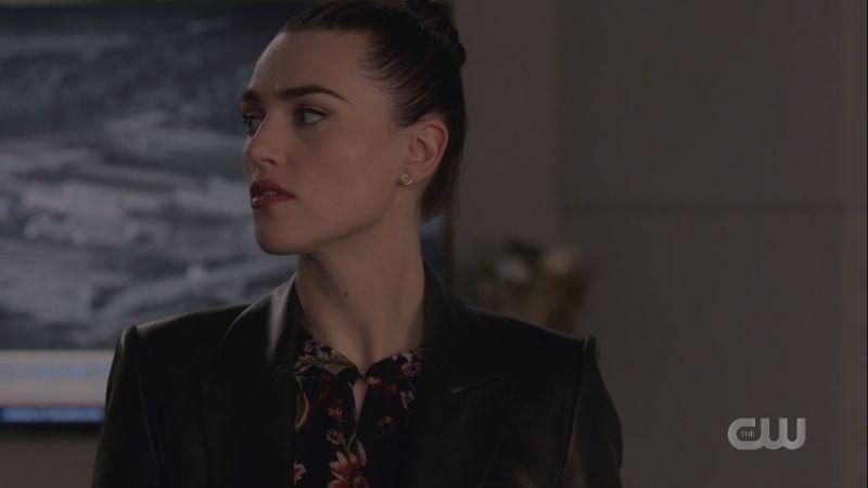 Lena looks toward Alex