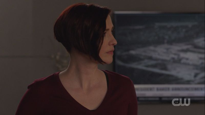 Alex looks toward Lena