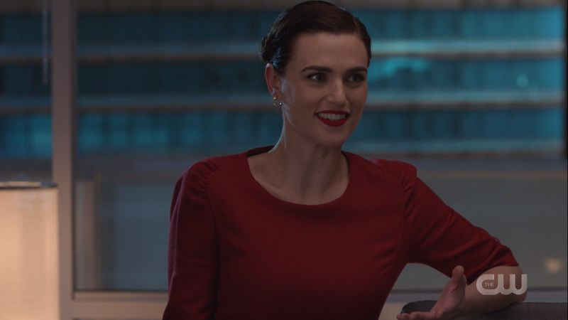 Lena smiles and her hair is pinned up all cute