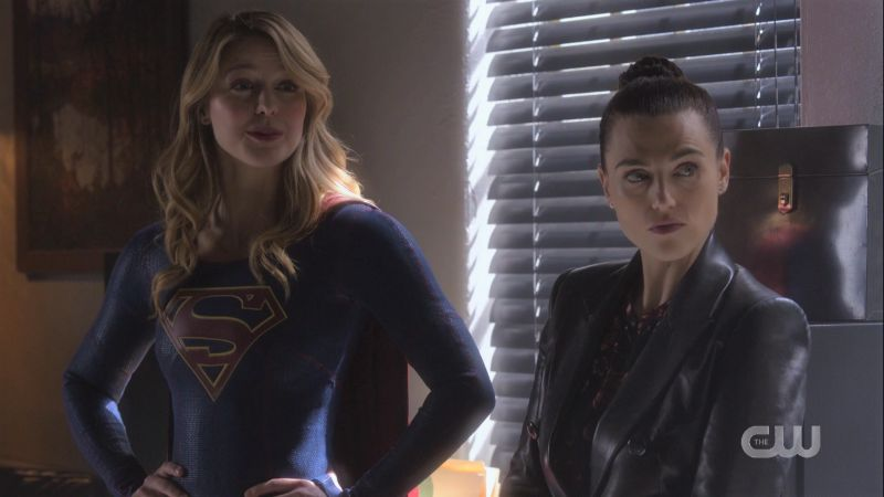 Supergirl and Lena are in slat-blind lighting looking like they're in a noir film