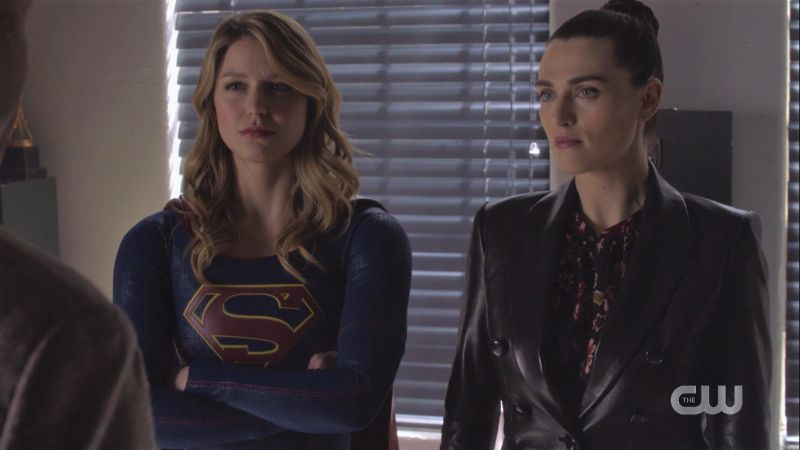 Supergirl crosses her arms, Lena's wearing a leather jacket, all is gay and beautiful