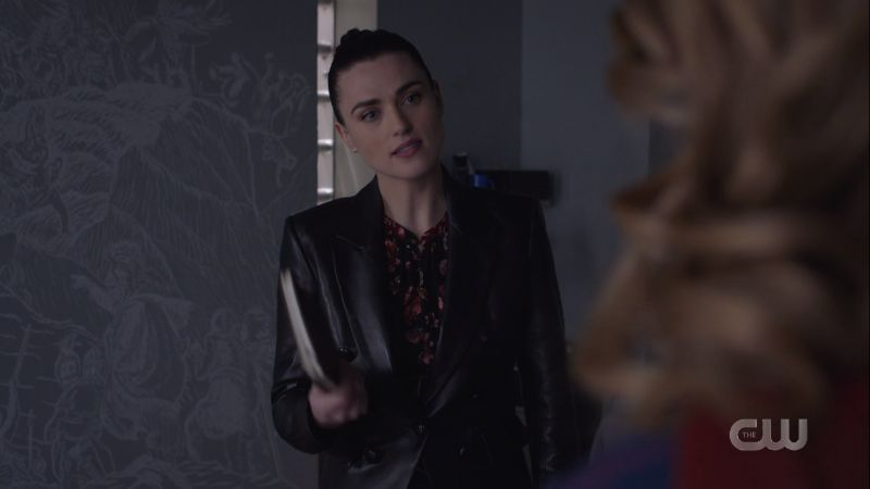 Lena holds one of Lex's diaries in disbelief