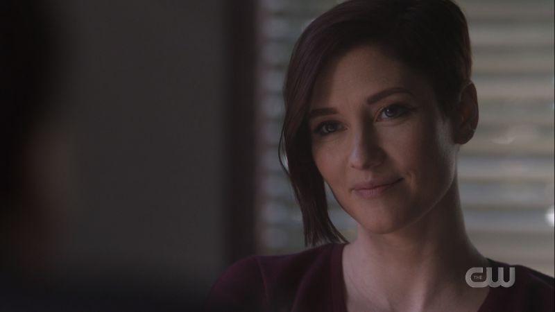 Alex smiles softly at Kelly