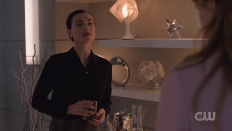 Lena has a drink in her hand and looks pretty bummed