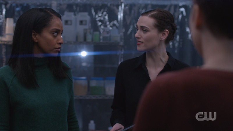 Lena looks distraught in her lab; Kelly is next to her