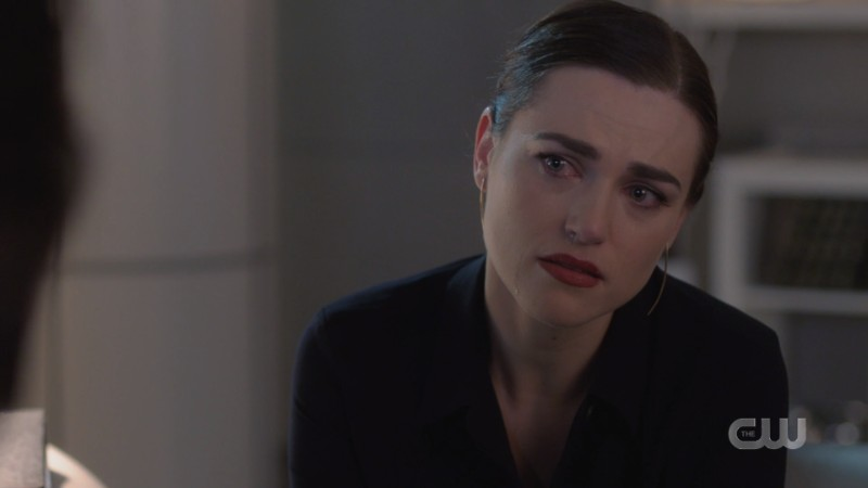 Lena listens thoughtfully and tearfully to Brainy