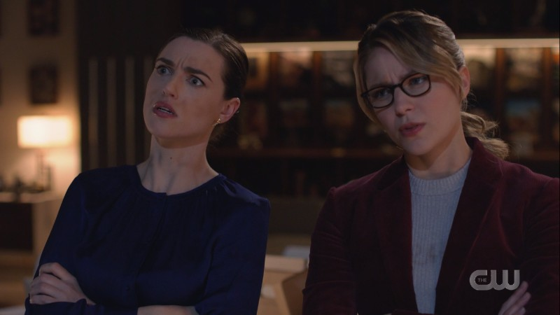 Lena and Kara look confusedly at the murderboard