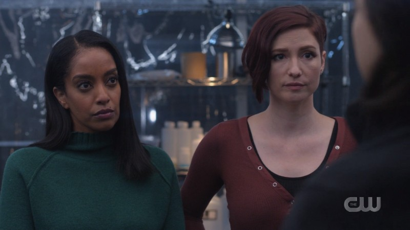 Kara and Alex look on, worried