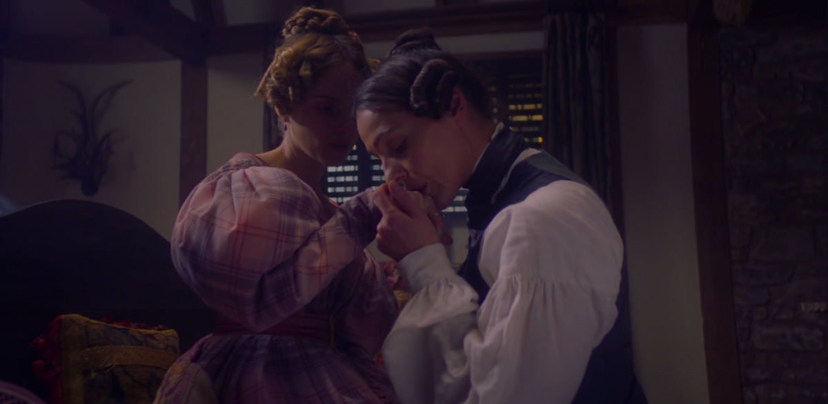 Anne Lister kissing Miss Walker's hand in the Snow White fuck cabin