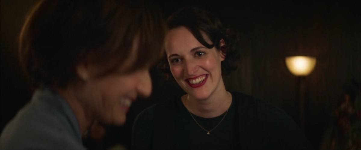 Image: Fleabag looks at Belinda, a lesbian priest, while they are both at a bar
