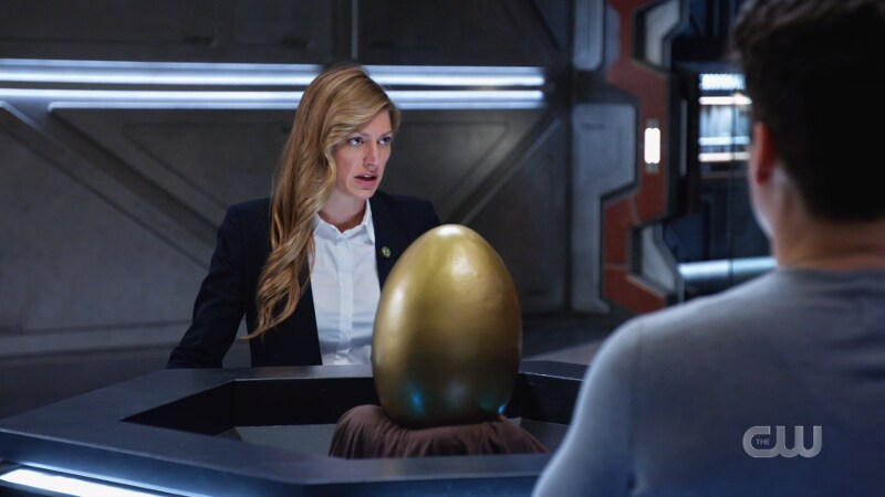 Ava speaks to the Legends with the Egg just chilling in frame