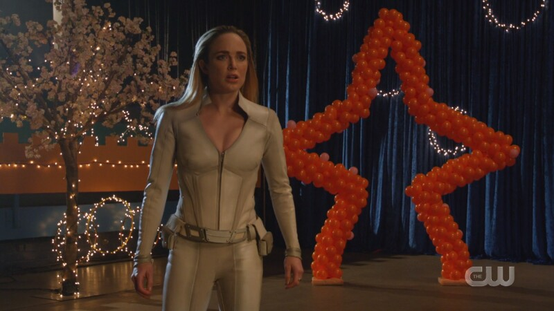 Sara watches in horror in her white canary suit