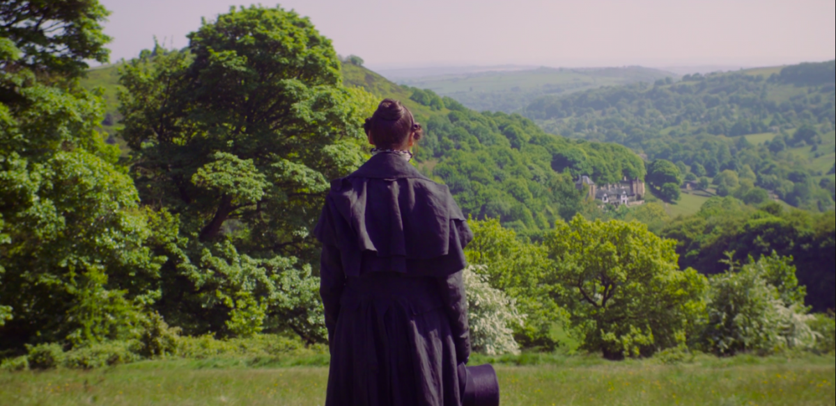Anne Lister, back to us, looking over Shibden Hall