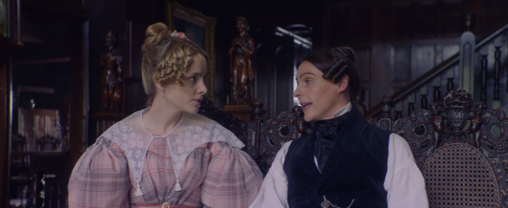 Anne Lister maintaining eye contact with Miss Walker as she says the word 'sex' in front of their families