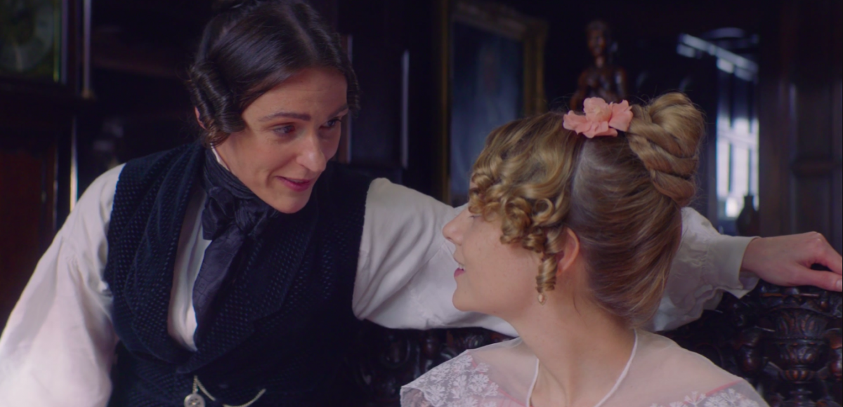Anne Lister perched on the arm of Miss Walker's seat