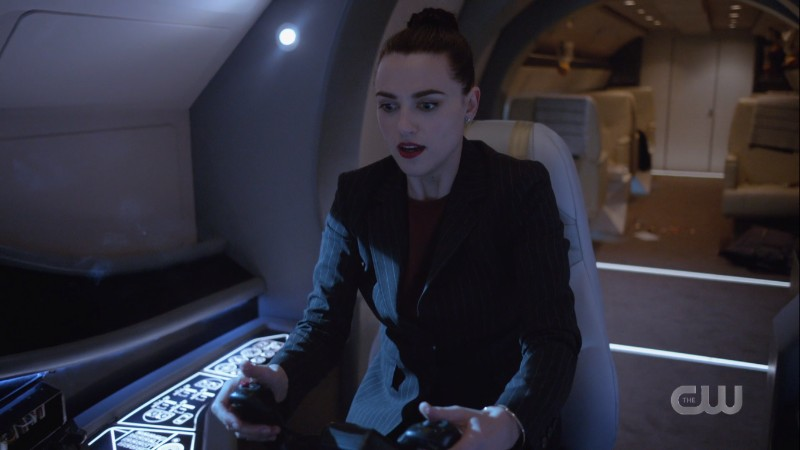 Lena holds the controllers in the cockpit