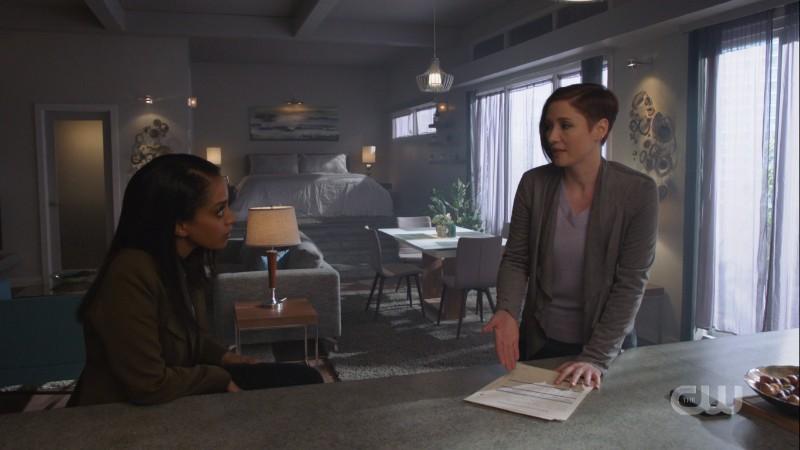 Alex and Kelly talk in Alex's loft