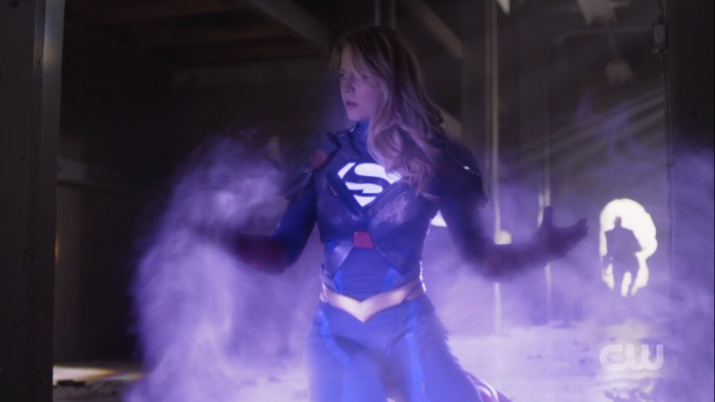 Supergirl absorbs the purple energy of Red Daughter
