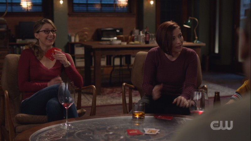 Alex talks intensely about game night while Kara laughs