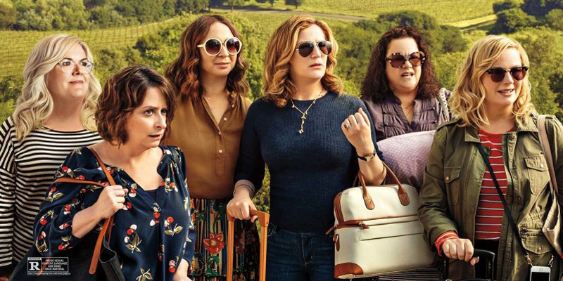 a group of women friends on a wine tour