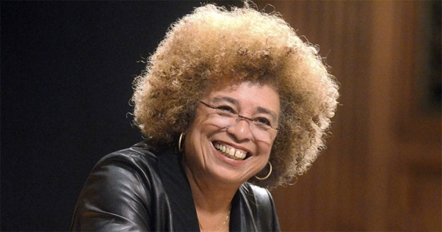 A recent photo of Angela Davis smiling in the 2010s. Angela Davis is a key figure in Black August.