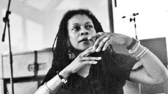 A black and white photo of Assata Shakur from the 1970s.