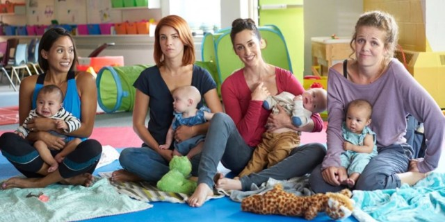 four main characters of Workin Moms holding their babies