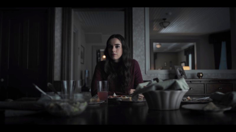 jenna sits alone at a table