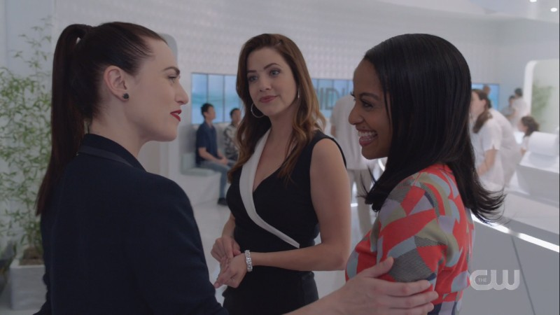 Lena and Kelly beam at each other while Andrea watches