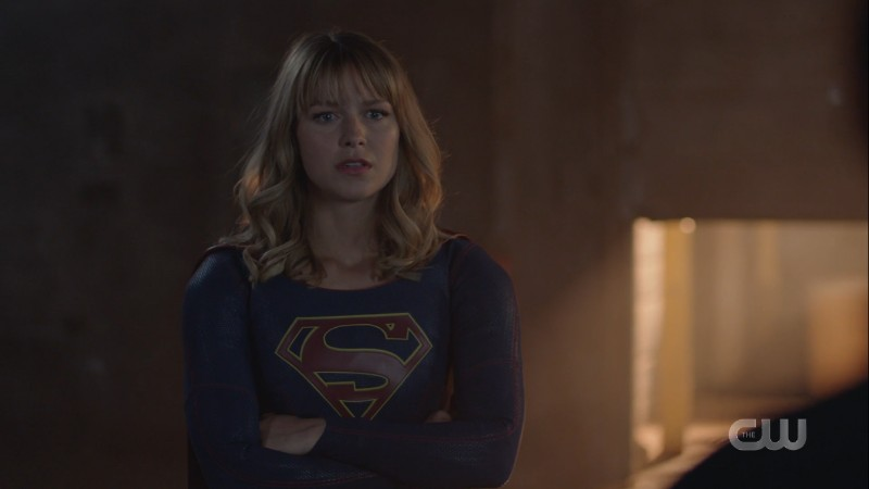 Supergirl crosses her arms