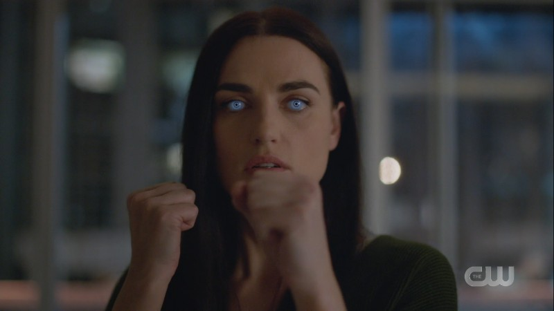 Lena has her white eyeball VR contacts in and her fists up