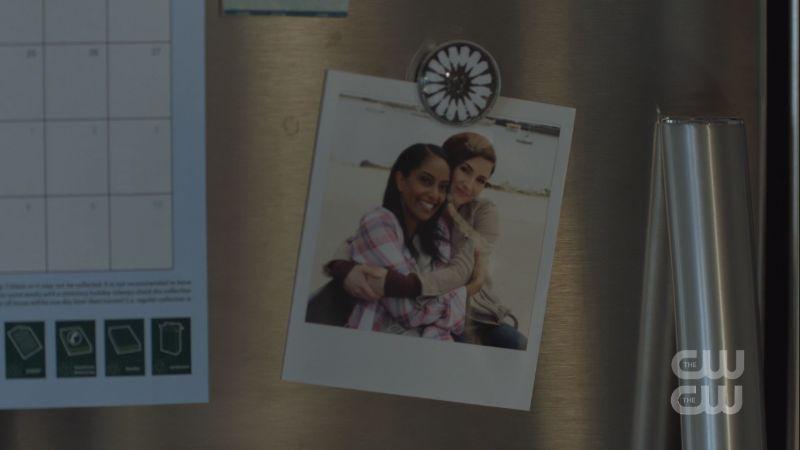 alex and kelly polaroid on the fridge