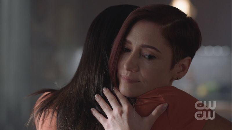 alex looked worried as she hugs kelly
