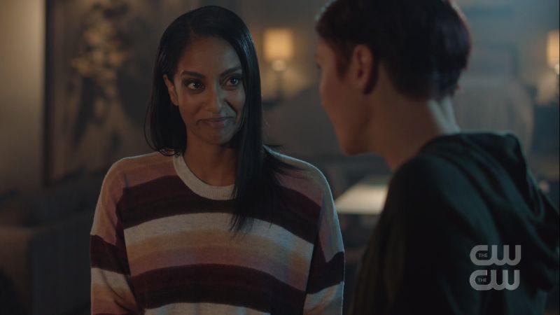 Kelly smiles at Alex