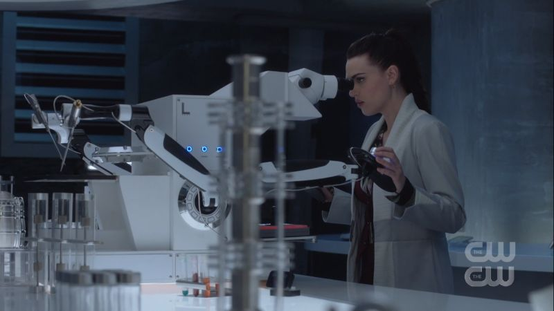 lena looks through a microscope