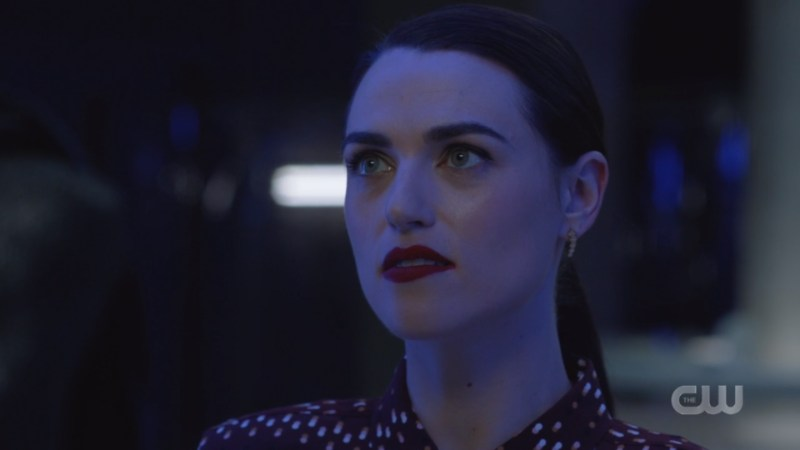 lena looks darkly into the cell