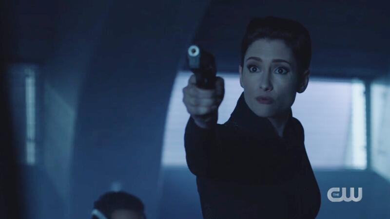 Alex angrily points her gun