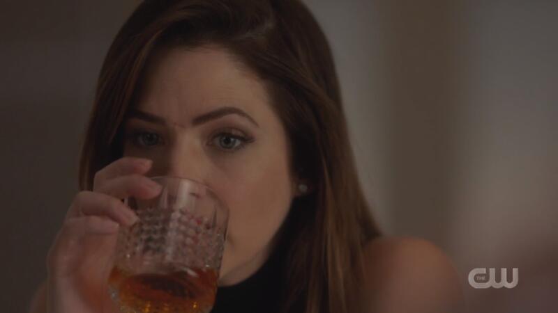 Andrea takes a swig