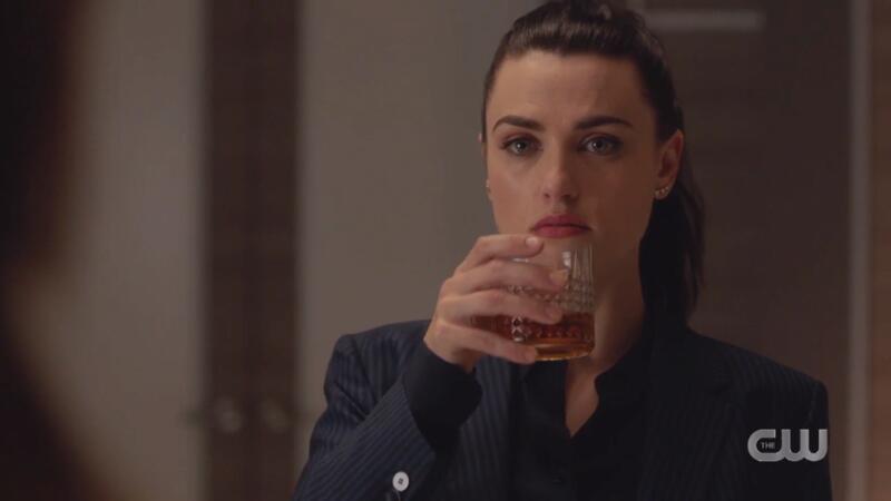 Lena sips her drink menacingly