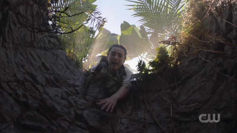 Lena reaches down a hole