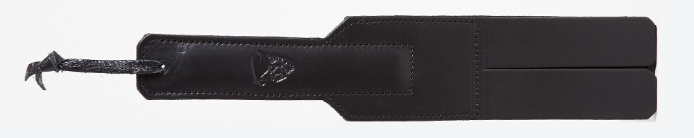 a black rectangular slapper with two tongues